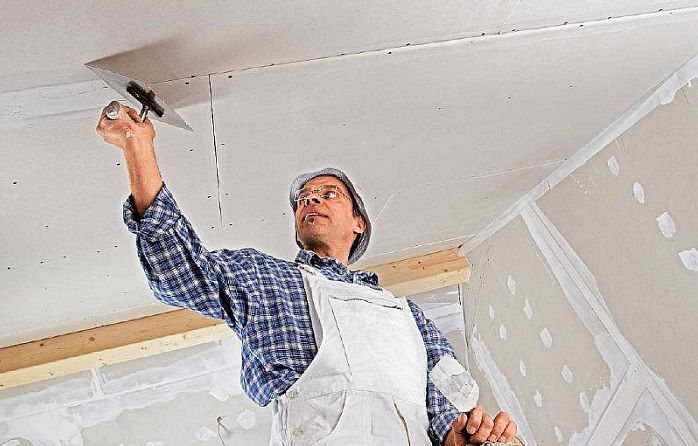 Снимок работ по шпаклевке подвесного потолка