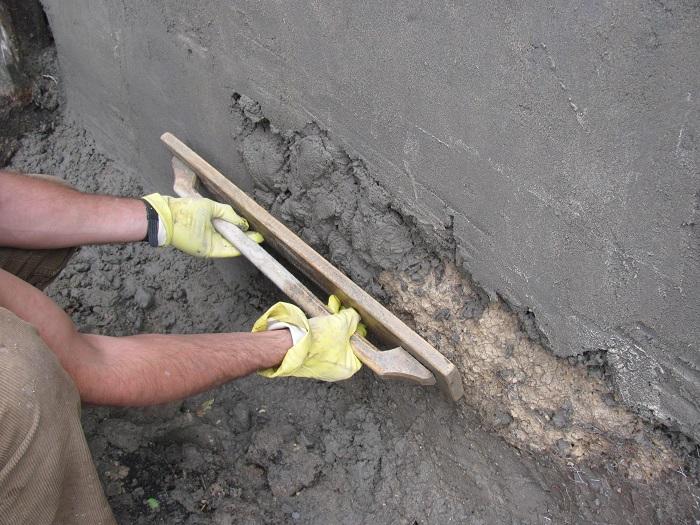 Фотография штукатурки стен цементно-песчаной смесью