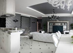 Совмещённая чёрно-белая гостиная со столовой и кухней