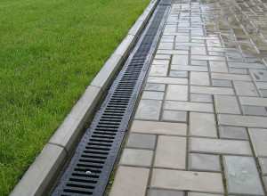 Фото открытой ливневой канализации, kostromaplotnik.ru