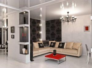 Чёрно-белая гостиная с красным столиком